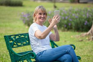 woman on cell phone in summer sun