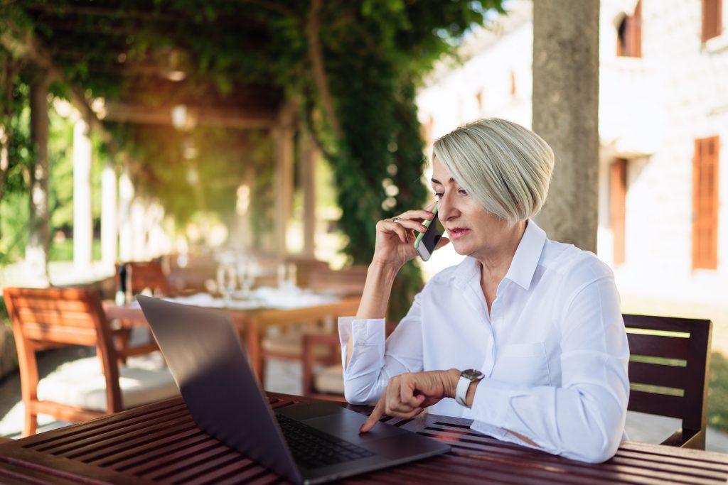Woman using WiFi in cafe.